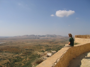 Student looking at the panoramic landscape from Berber village of Takrouna