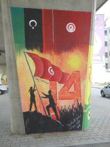 Revolutionaries from Tunisia andLibya raising the Tunisian flag.